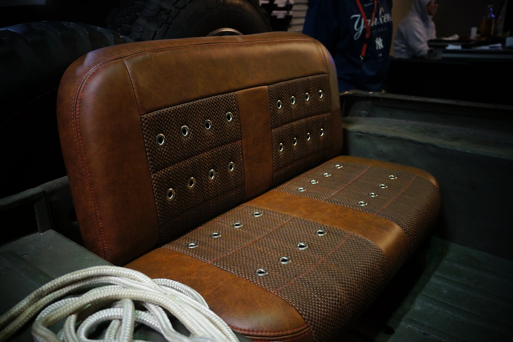 Relicate Rich Clay Distressed Leather Hides on Jeep bench seat with woven leather
