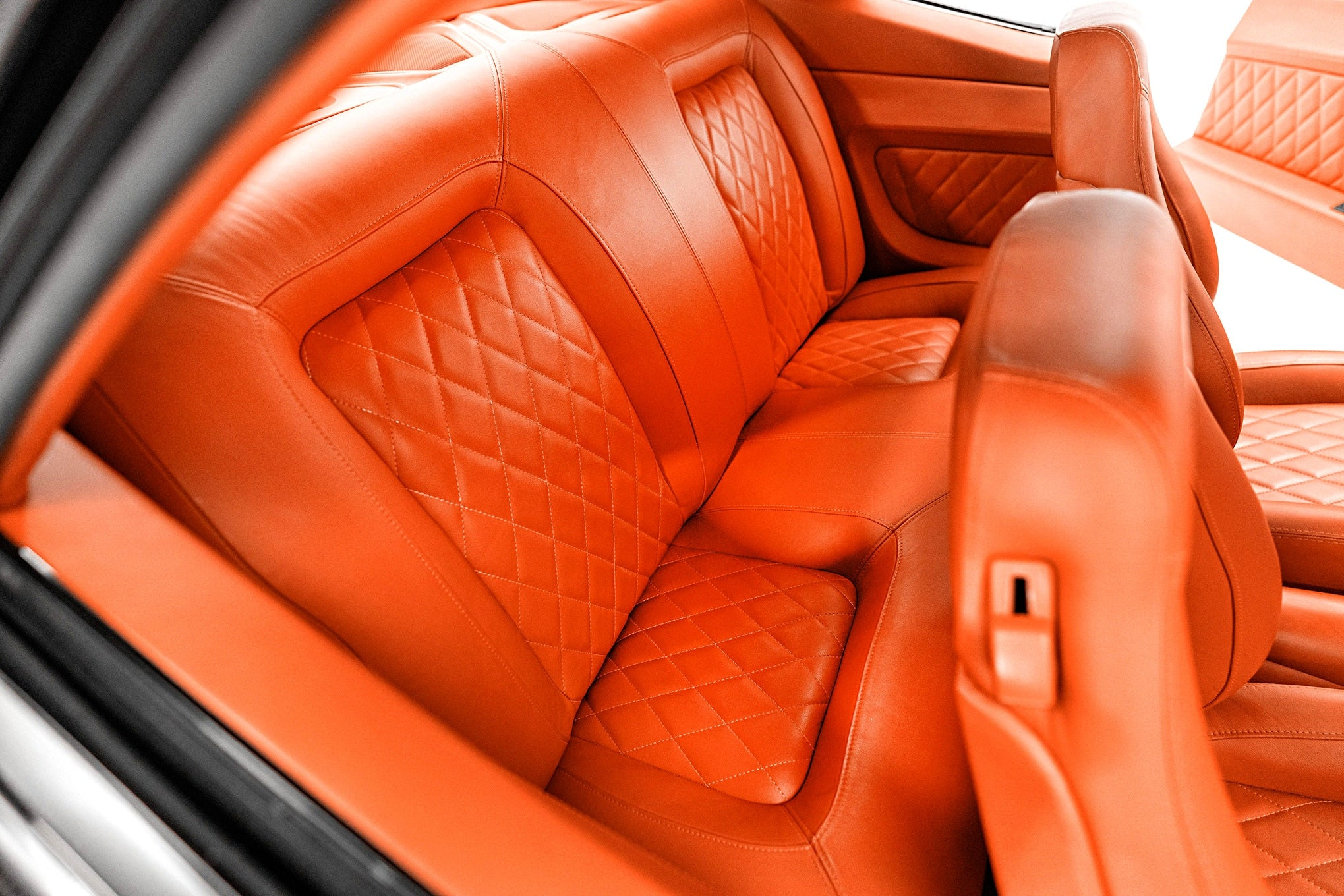 Classic Car Studio Relicate Orange Leather 1969 Camaro interior Back Seat