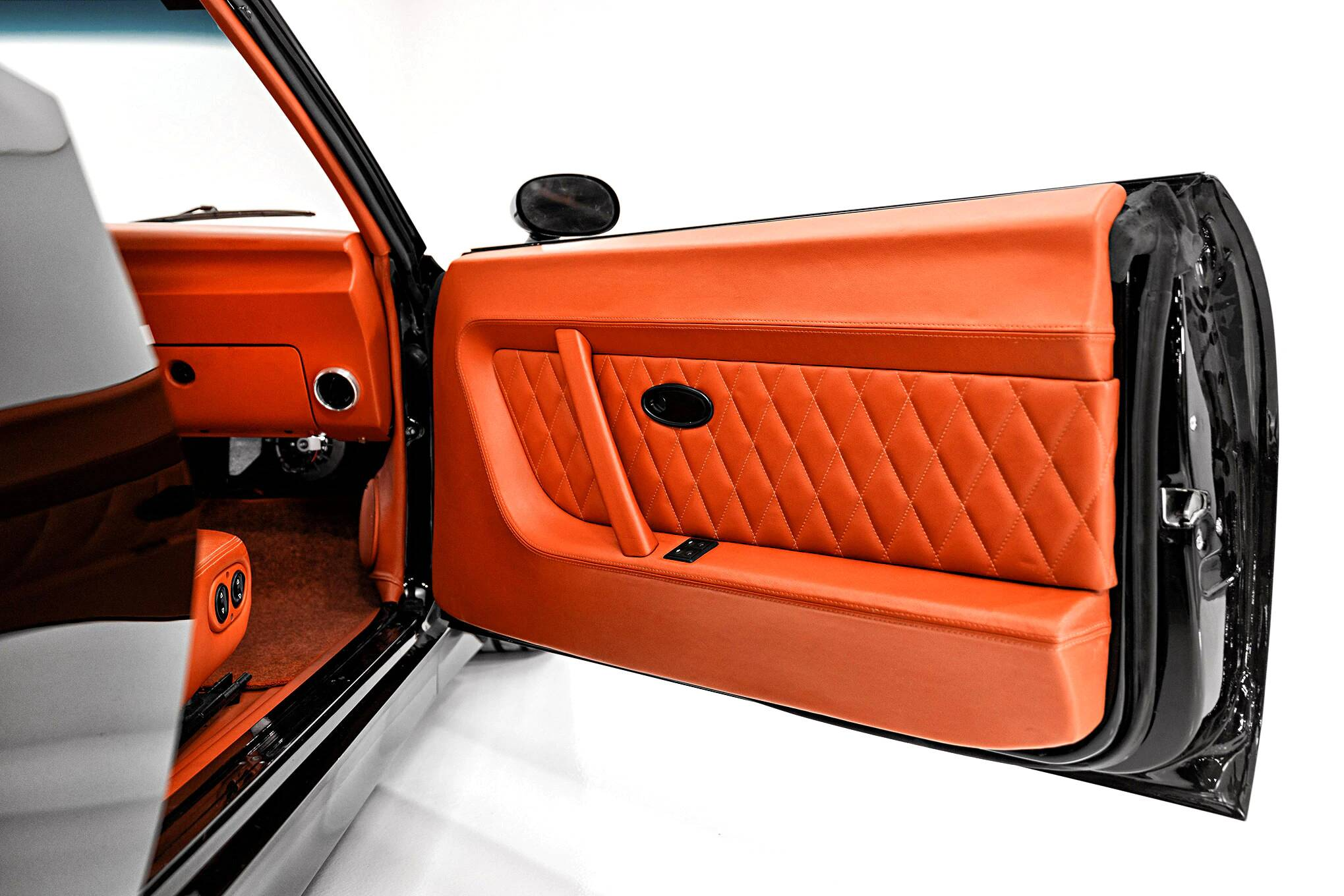 Classic Car Studio Relicate Orange Leather 1969 Camaro interior door panel diamond stitch