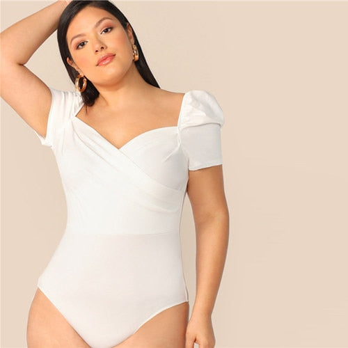 Outgoing Women's Plus Size White Puff Sleeve Wrap Front Bodysuit.
