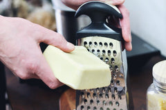 grating beeswax for homemade chapstick