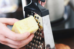 Grating beeswax for DIY vapor rub using essential oils