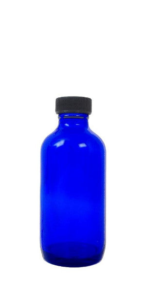blue glass bottle with cap
