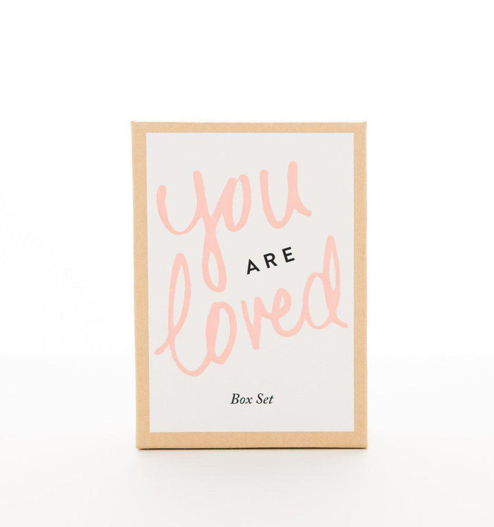 "You are loved gift set.  Gift box containing the words ""You are loved"" in pink and black on the front."