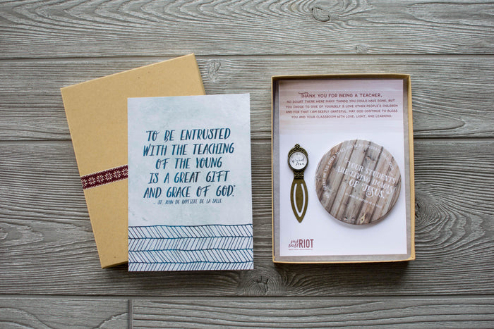 "Teacher gift. Great Christmas gift for teachers.  Image of gift box and the following contents: Specially created to be gender neutral and useful to both male and female teachers, this box includes a ""Spread love"" bookmark, a coaster with a St. John de Baptiste de la Salle quote (Your students are living images of Jesus) and a short prayer (God, grant me the grace to see You in my students today. Amen.), and a 5×7 print of another de la Salle quote, as well as a heartfelt note of thanks."