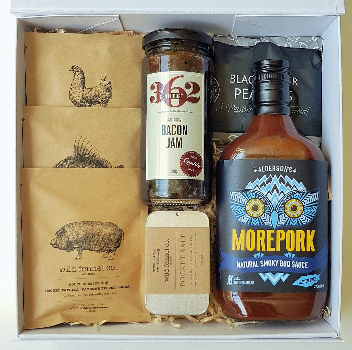 Boxsmith Food Gift Box featuring wild fennel seasonings, aldersons morepork sauce, wild fennel pocket salt, 362 wild south bourbon bacon jam & herb and spice black pepper peanuts. Easy NZ wide delivery of our online NZ food gifts