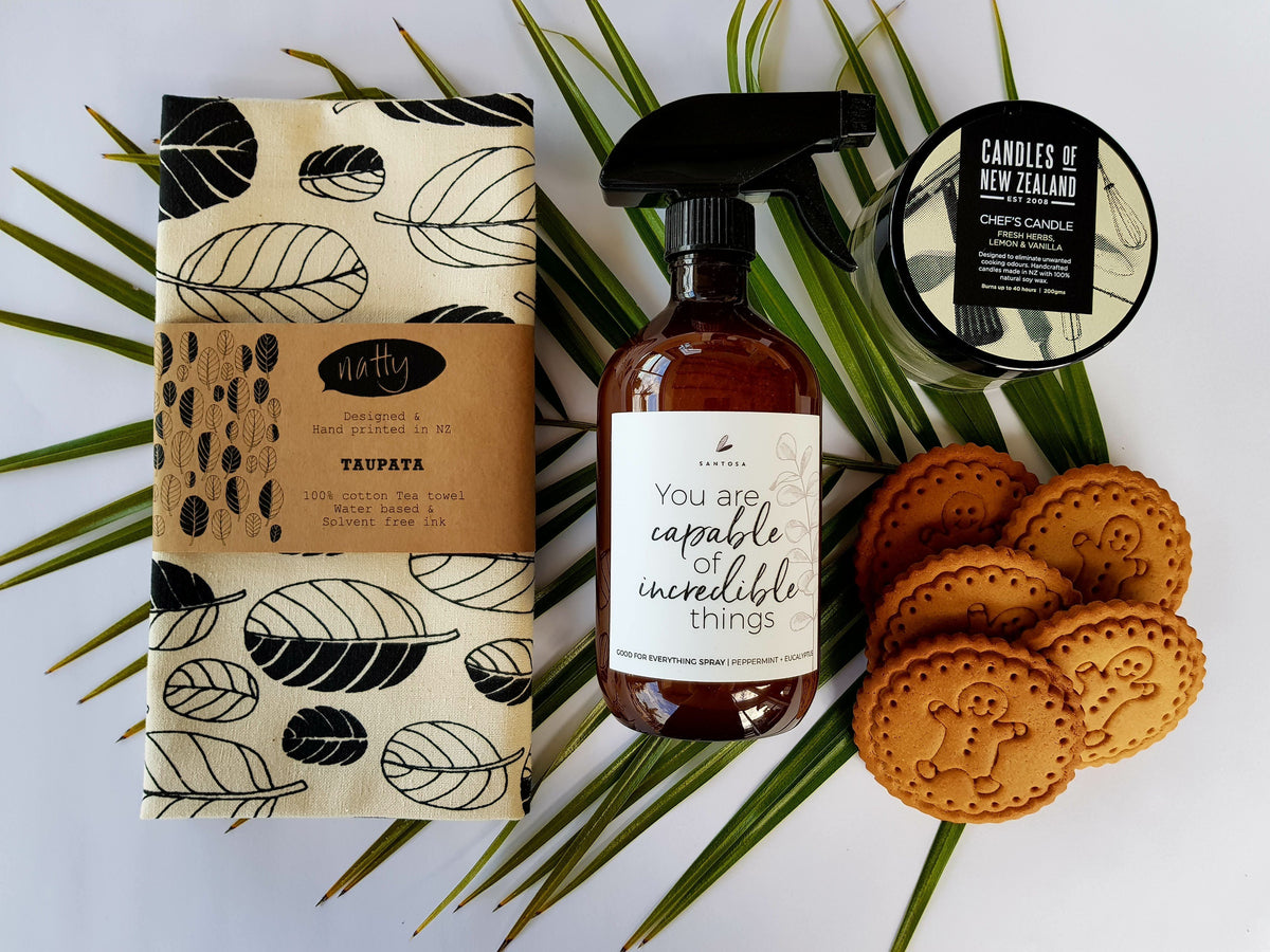 Flat lay of NZ online gift Housewarming Gift Box & gift hamper. Featuring premium eco NZ products. Ideal for new home gifts. Easy to deliver online gifts NZ wide