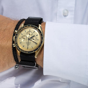 omega gold with black nato strap