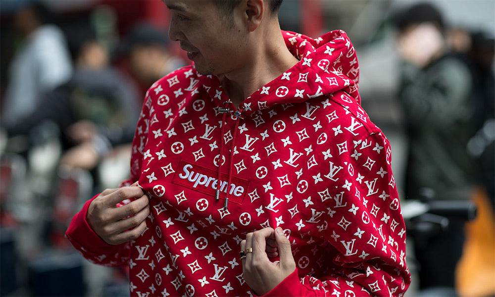 men wearing supreme hoodie