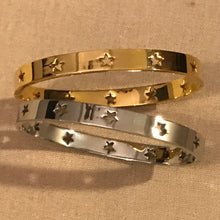 Star bangle in gold or silver.