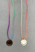 Happy smiley face disc pendant on neon cord
