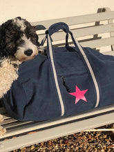 Duffle bag with star design.