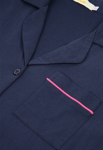 Navy blue pyjamas with bright pink trim