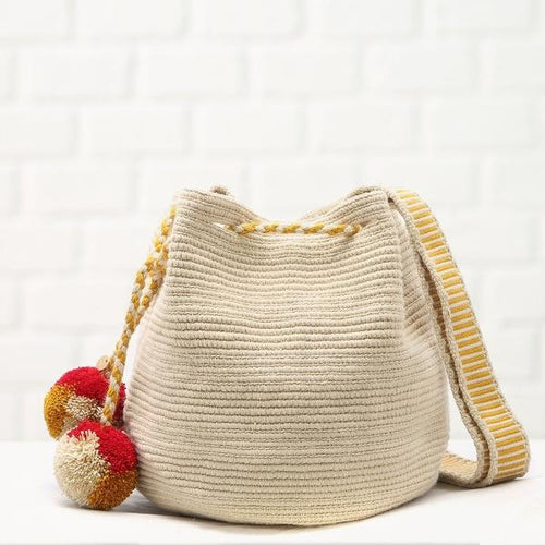 Chila Handmade Milena bag in beige with pompons and beoge and mustard strap