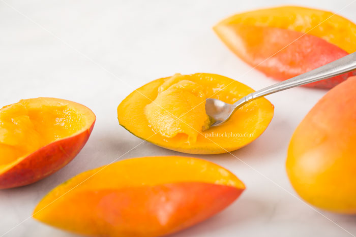 Mangos on White Marble Background
