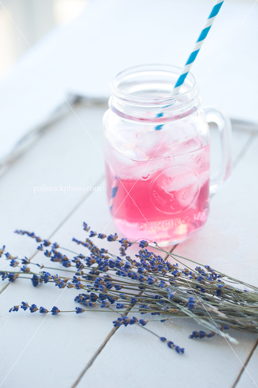 Pink lemonade and lavender on white backdrop