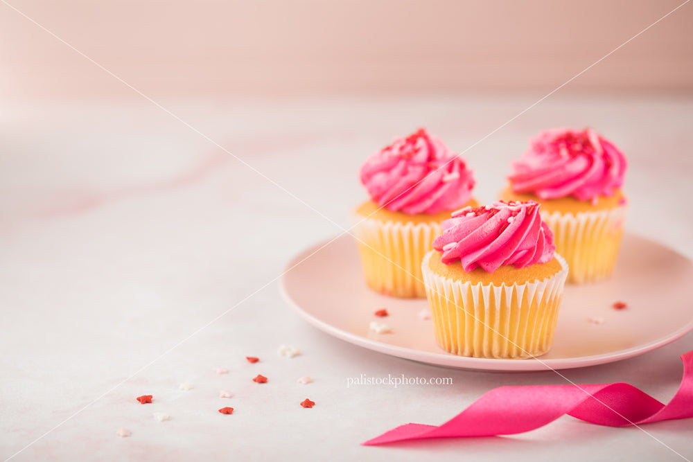 Valentine's Day Cupcakes with Sprinkles and Ribbon