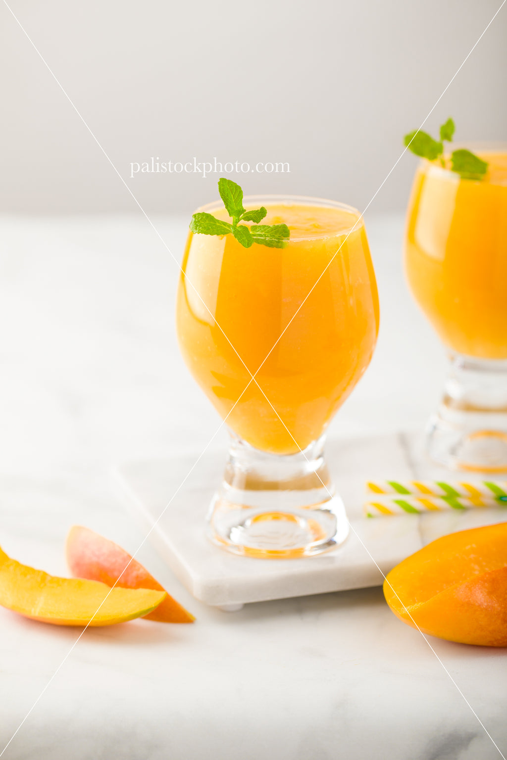 Mango Smoothie With Mint Leaves and Mango Slices