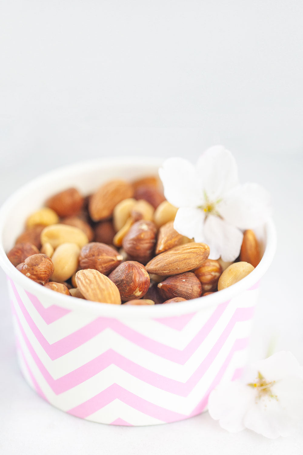 Nuts in a Pink Paper Cup