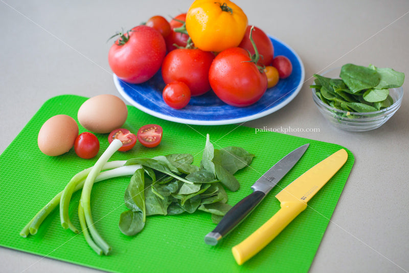 Arrangement of fresh vegetables and eggs on a cutting board