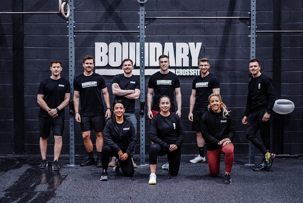 A group of young people posing for a photo at Boundary Fitness in Belfast.