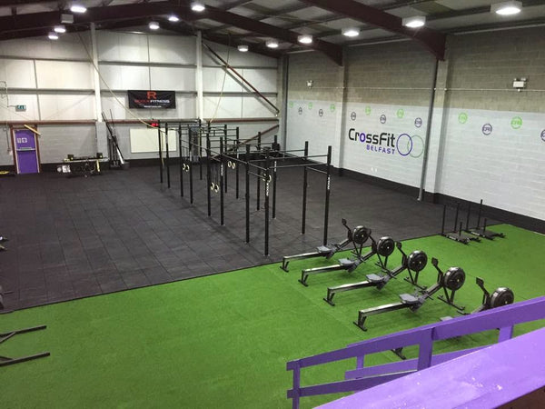 A view of the full CrossFit gym area including open space and gym equipment.