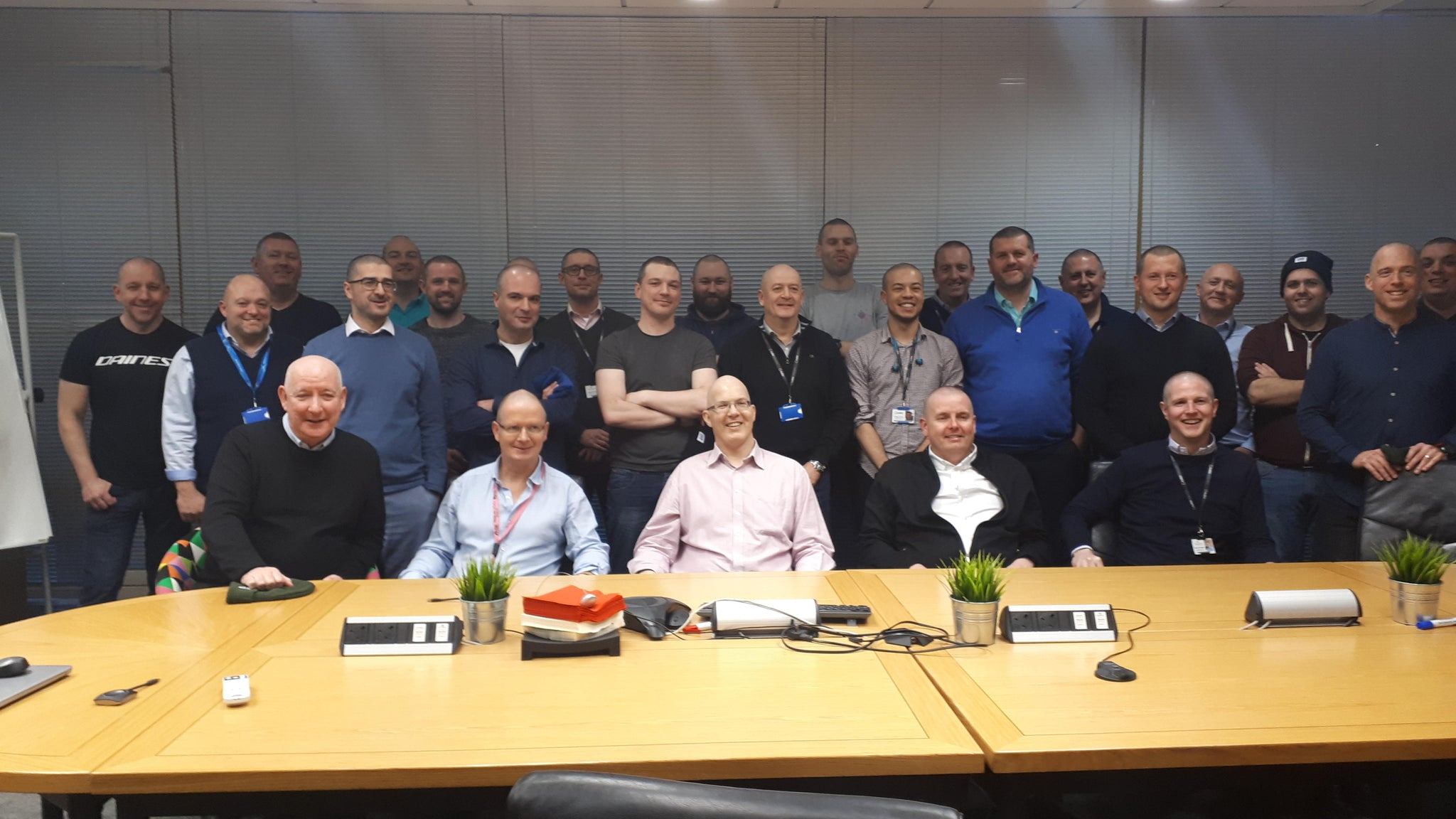 Cubic Telecom Team After Shaving Head for CFO Dave