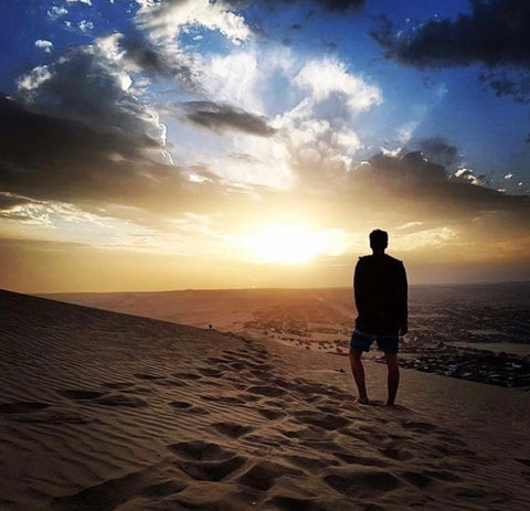 Darragh Lucey Hiking Sand Dunes in Huachina, Peru wearing Gym+Coffee gear