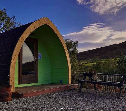 East Coast Glamping pod with an indoor wood-burning stove.