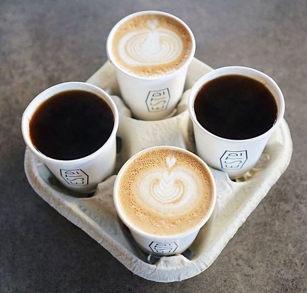 A selection of takeaway coffees ordered at Established Coffee