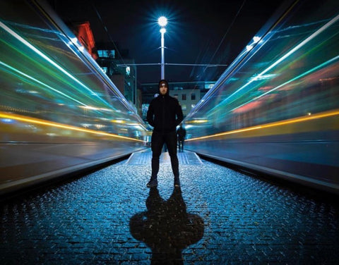Gym+Coffee Jet Black Hoodie on Harcourt Street with Luas Tram Light Tracks