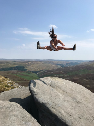 Clare-cryan-irish-diver-hiking-and-jumping-and-smiling