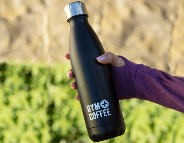 Stainless-steel-waterbottle-gym-plus-coffee-resuable-waterbottle-held-by-woman
