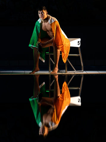 Irish-Swimmer-Darragh-Greene-posing-with-Irish-flag