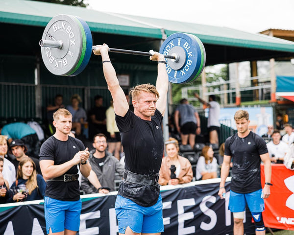 Fred Ray completing a ground to overhead barbell lift at the London Turf Games