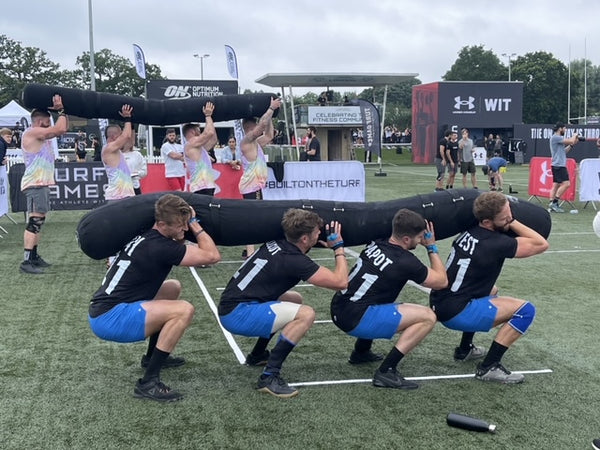 Team Gym+Coffee completing the Worm exercise at the London Turf Games