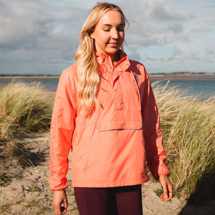 Gym plus coffee shop womens coral orange meraki windbreaker on beach