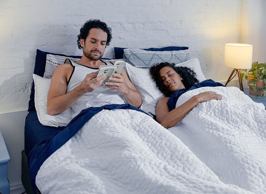 couple in bed preparing to sleep