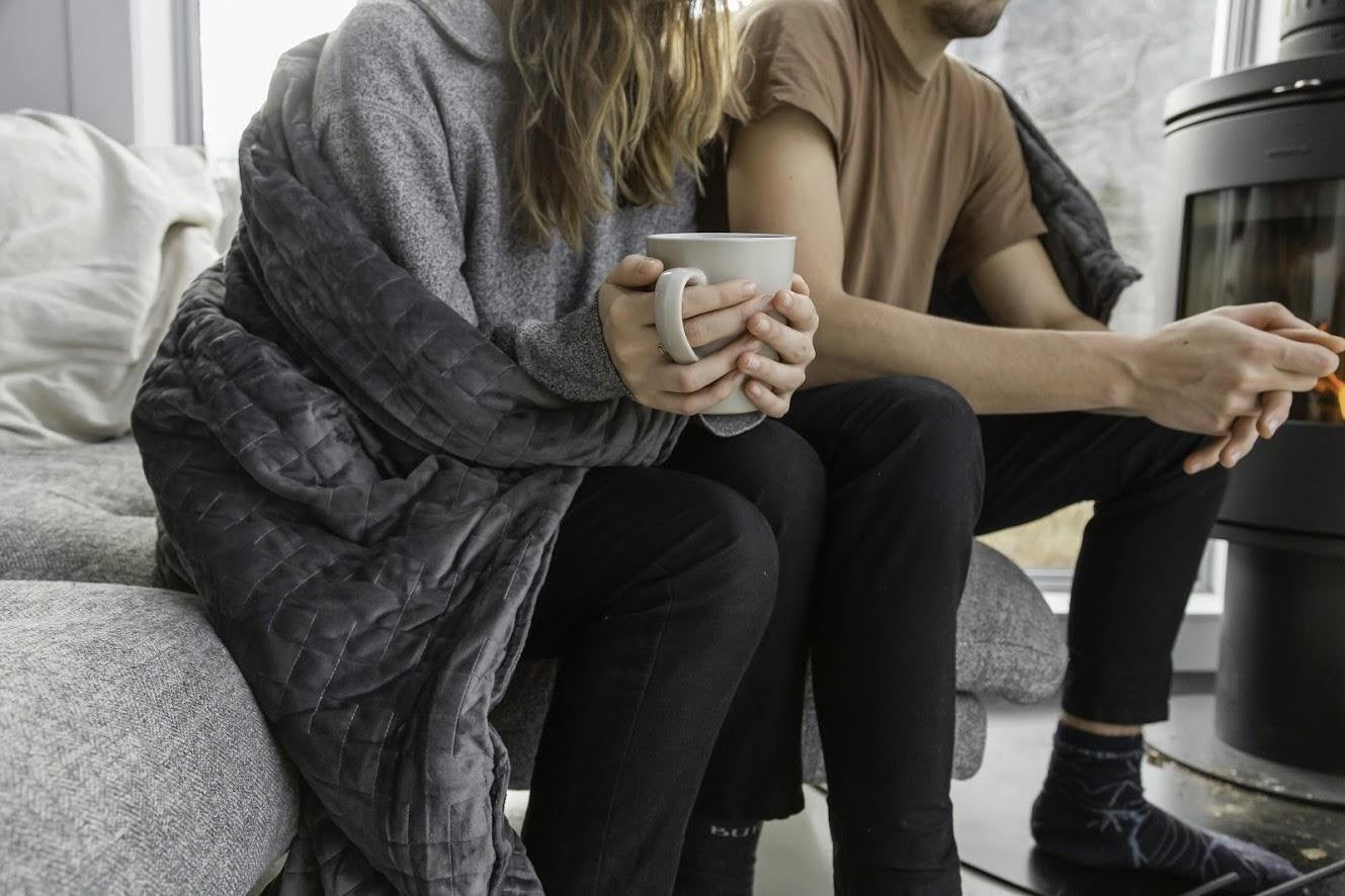 couple wrapped in gravity blanket