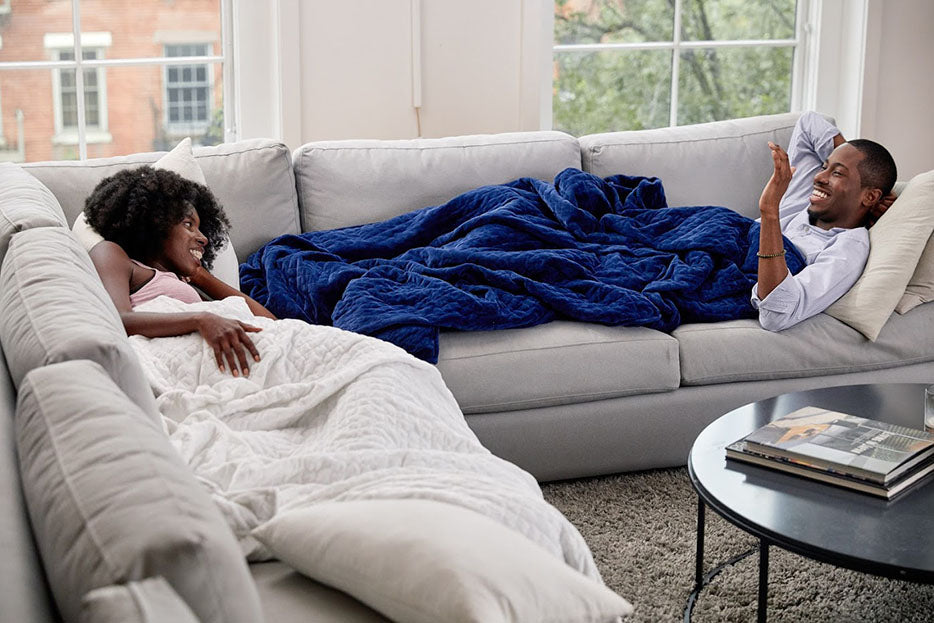 pair on couches with blankets