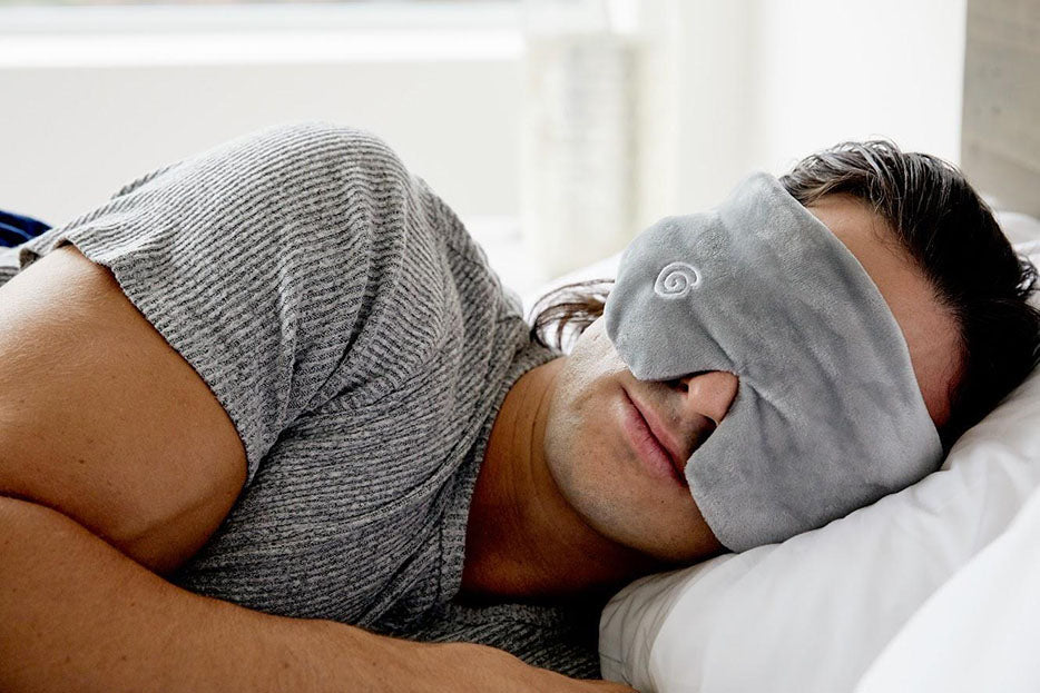 sleeping woman wearing weighted face mask