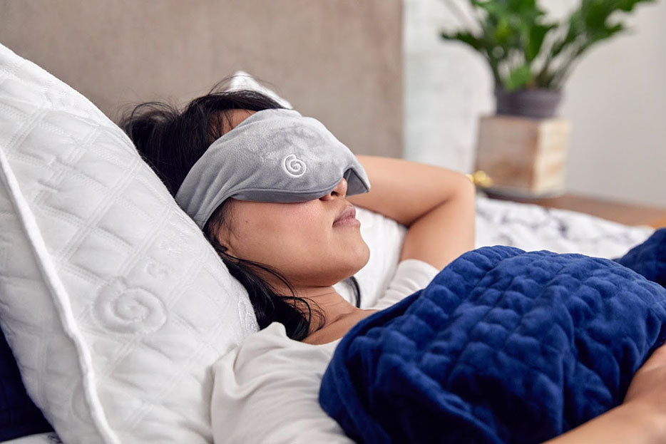 woman wearing weighted eye mask