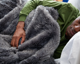 Man Sleeping with Faux Fur Duvet Cover in Grey