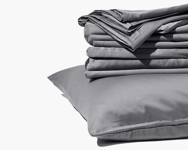 Gravity Bamboo Sheets in grey folded on top of pillow