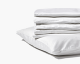 Gravity Bamboo Sheets in white folded on top of pillow