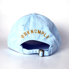 Broken Complex Gold Monogram Dad Hat