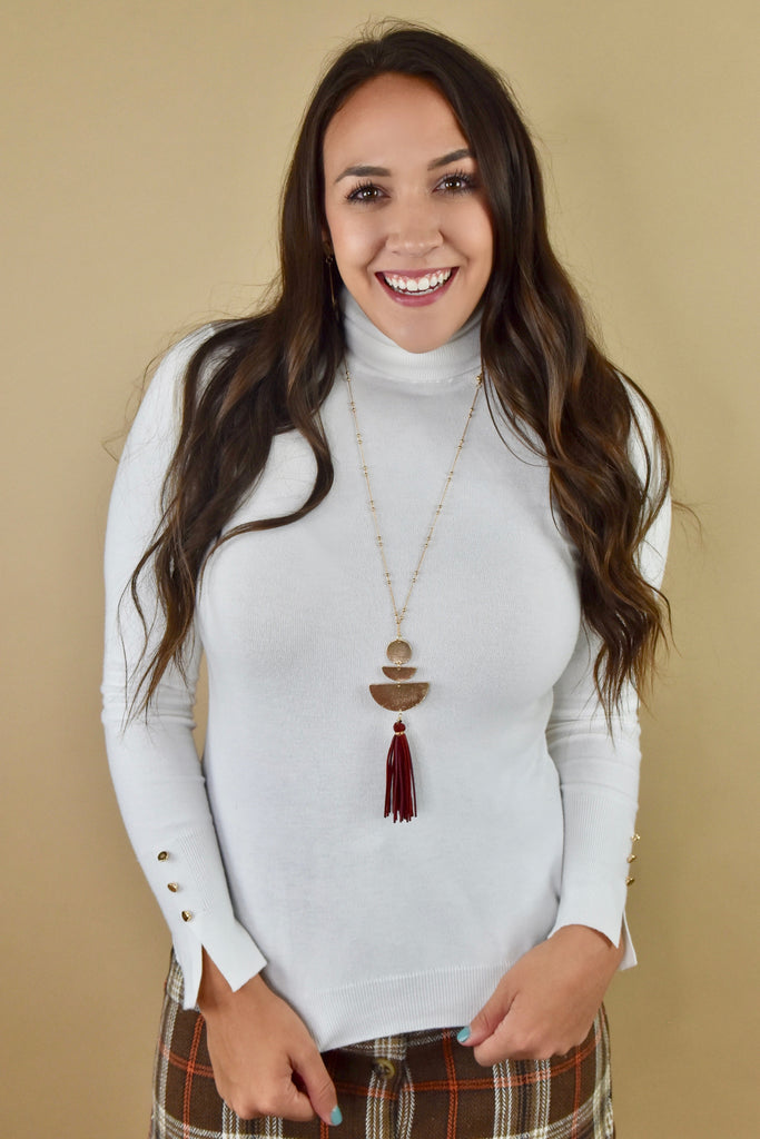 White Turtleneck Sweater with Gold Details