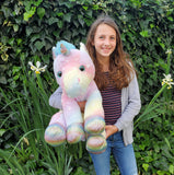 Large  Rainbow Unicorn and Donated Stuffed Animal