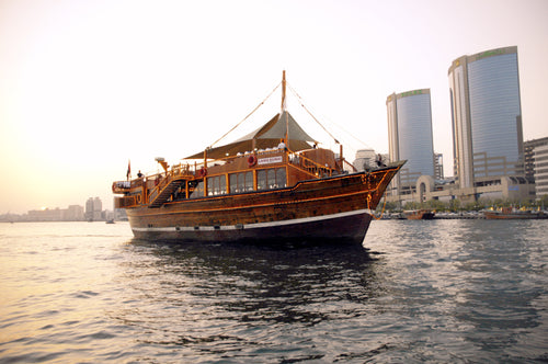 Experience Floating Restaurant is a traditional wooden Dhow  which offers you a romantic cruise and dinner under the moonlight with the view of the amazing city of Dubai.  One can enjoy a true portrait of old and new Dubai with delicious cuisines from around the world. Enjoy the old splendid architecture through Sheikh Saeed House, and the Heritage village which are reminiscent of years gone by. Also experience the modern architecture of Dubai like Dubai Creek Golf and Yacht Club, Chamber of Commerce, Natio