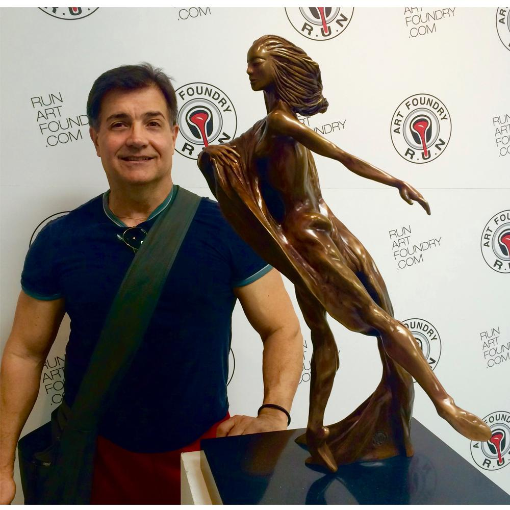 "Noel in front of his sculpture, ""The Dancer II""."